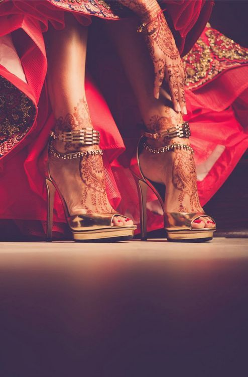 Love this portrait shot of the Indian bridal shoes with the red lehenga. #Frugal2Fab