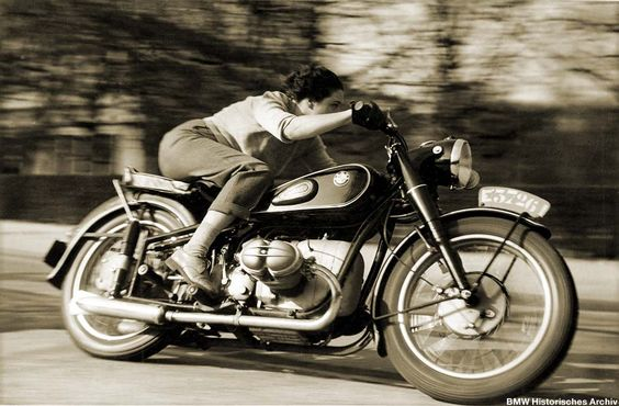 Belgian Journalist Marianne Weber testing the brand new BMW R68 for French magazine Motocyclette (April 1952) | Photographer: R.G.Everts