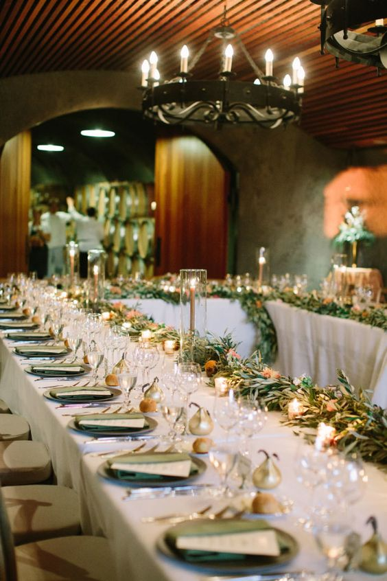 Romantic fall garland covered tablescape: http://www.stylemepretty.com/2016/03/04/california-winery-wedding-with-a-mountaintop-ceremony/   Photography: This Love of Yours - http://thisloveofyours.com/