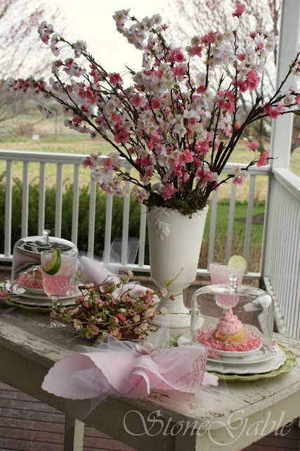 Beautiful girly table setting with cherry blossoms. I actually have the exact same vase that the cherry blossom branches are in. Pretty neat...