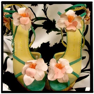 Charlotte Olympia has earned a cult following for good reason: elegant shapes, vibrant colors, and sky-high heels. These are from her upcoming resort collection, out in late fall, which includes a hefty nod to her mother's Brazilian heritage. We love the illusion of pretty petals climbing up your feet and the island vibe of the faux wooden platform and heel.