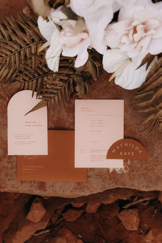 Arched wedding stationery and signs