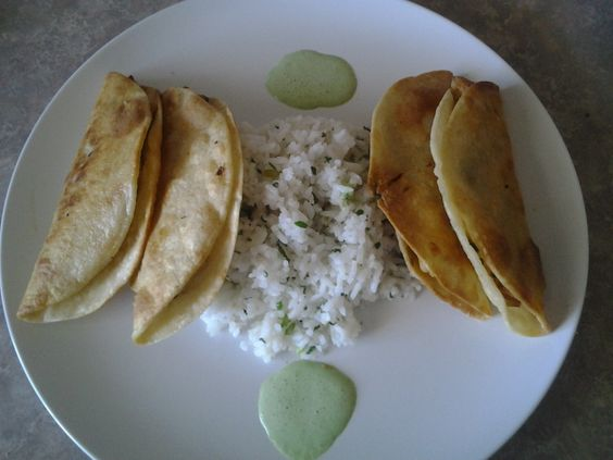 Chicken Empanadas with Cilantro Cream Sauce