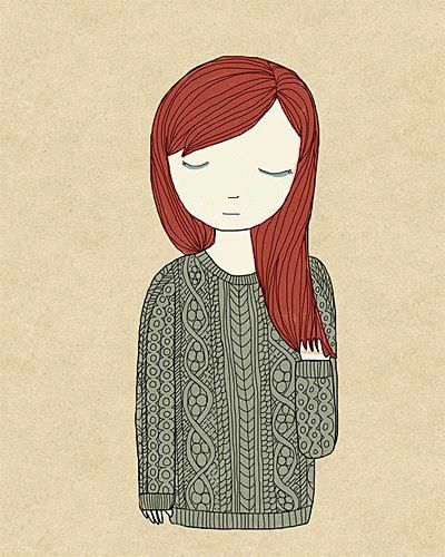 Menina ruiva com tricô e de olhos fechados.