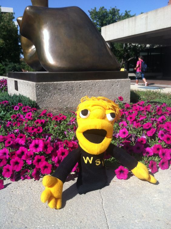 We Wu enjoying the flowers.