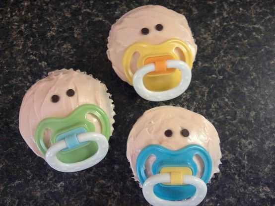 These would be great for a baby shower and also if you're bringing a new mom a meal, these would be fun to deliver for dessert! It just looks like some tinted cream cheese or vanilla frosting, 2 mini chocolate chips for the eyes, and some pacifiers!