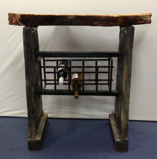 """Concrete Metal and Wood Wine Rack. This piece is one of a kind. The sides are made of concrete, the piece that holds the wine is metal and the top portion (which is also removable) is made of wood. The wine rack is $370.00 with the wood top and is 37""""H x 41""""W. The rack without the wood top $275.00 and is 27""""W x 33.5""""H http://www.recowarehouse.com/"""