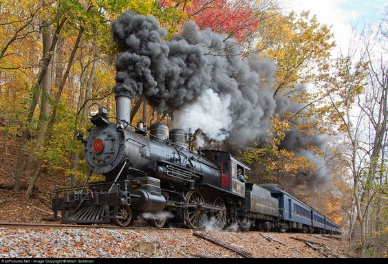 Racing through the seasonally colorful backwoods of Delaware, W&W #98 pulls an Autumn Leaf Excursion through Yorklyn, captured here paralleling Creek Road. The second of two trips, this train ran past the normal terminus of Mt Cuba and on all the way to Hockessin, DE.