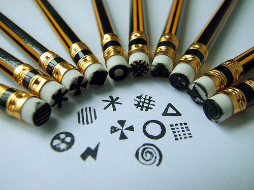 Carve rubber stamps from pencil erasers. This is not a tutorial but you get the idea from the photo.