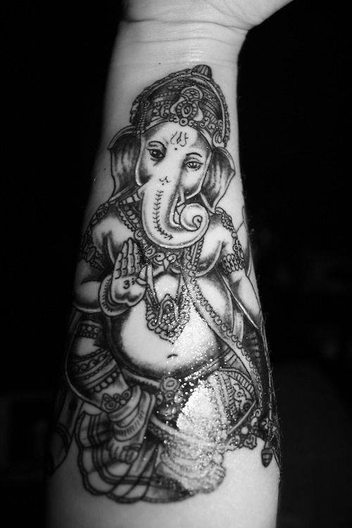I got the Hindu God Ganesh on my forearm because he is the lord of overcoming obstacles. This a powerful image for me because I've had my fair share of bad times. This tattoo reminds me that I've made it this far, so I can make it through anything that life throws at me in the future. This tattoo was done by the amazing artist, Josh Genatossio, at Dharma Ink in Easton, MA.