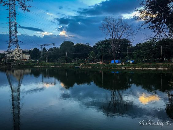 Double The Blue: Scene at my running track from a couple of days ago.  #bangalore #haralurlake #blue #sunset #lake #water #reflection #reflections #electric #iphone #iphone6s #iphoneography #trails #nature #indigo