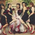 Love the bridesmaids dresses and how the wedding dress has red and black tulle added to it....