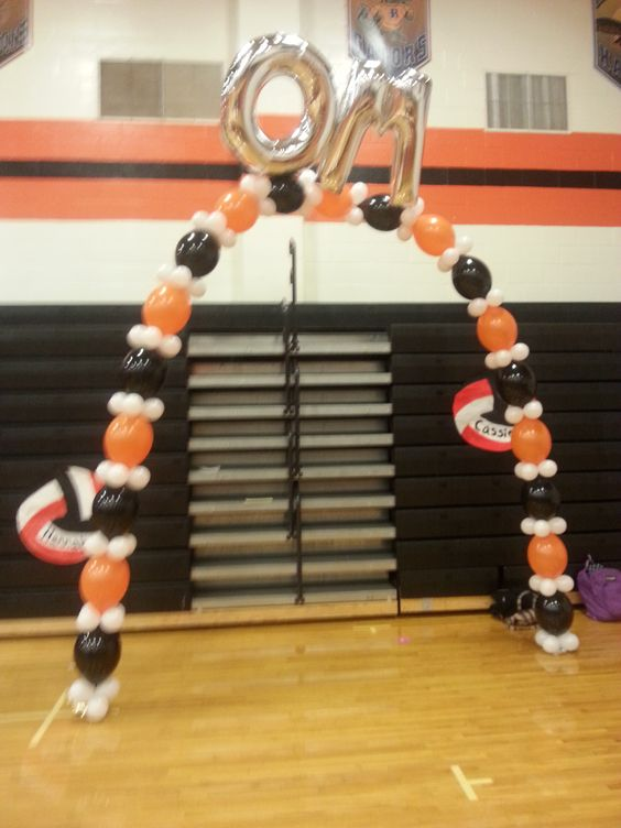 """Balloon arch, Link'O'Loon balloon arch, High School Senior Game, Oakland Mills High School Volleyball, Orange and black balloons, balloon letters on arch, 40"""" silver balloon letters"""