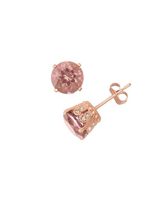 David Tutera Morganite Quartz & White Sapphire Round-Cut Stud Earrings | zulily  . $39.49 Compare at $130.00  Product Description:  From the stunning collection of David Tutera, these captivating stud earrings transform your everyday looks with simple dazzling style.      7.25 mm diameter     14k rose gold-plated silver / morganite quartz / lab-created white sapphire     Imported