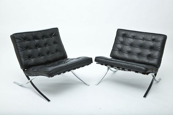 Two gorgeous Barcelona style chairs. Not original but very good knockoffs