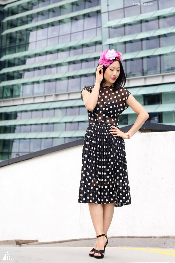 The polka dot print and sheer fabric of this vintage dress is perfect. The full skirt means heels are a must to get maximum swish.