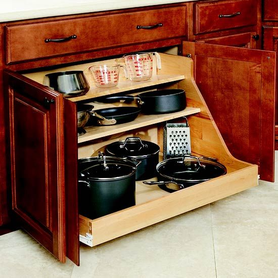 Add pullout shelves to turn every inch of a deep cabinet into accessible and useful storage. Pots and pans formerly lost in the back recesses of these cabinets are now easy to locate.