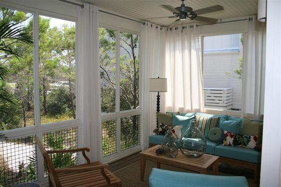 Beach house window treatment ideas hgtv idea house for Exterior window dressing ideas