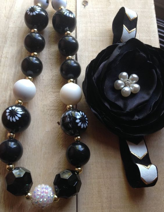 A personal favorite from my Etsy shop https://www.etsy.com/listing/231404912/black-gold-and-white-bubblegum-necklace