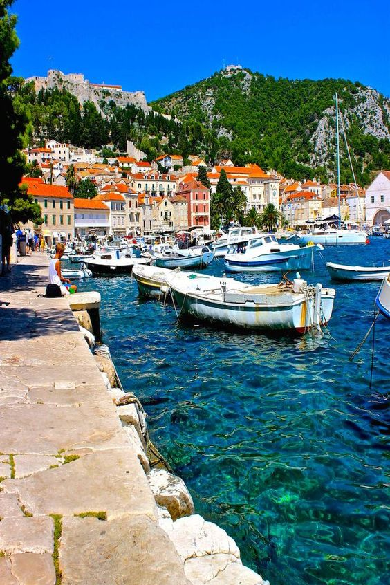 The beautiful blue waters of Hvar Croatia with the fort overlooking the bay