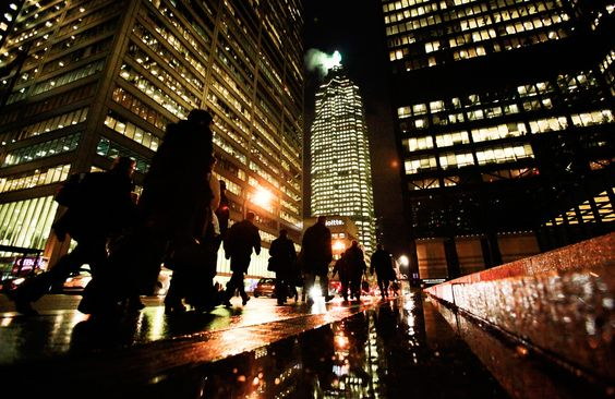 People walk down Bay St in the heart of the financial district in downtown Toronto