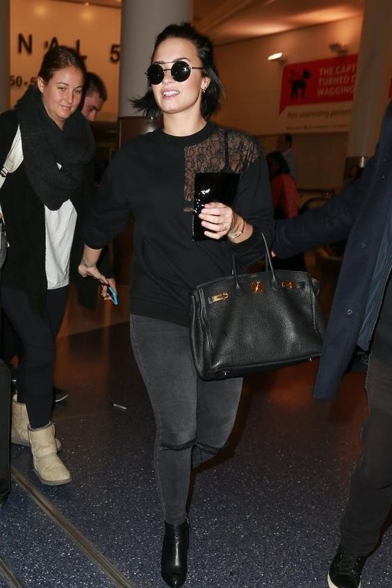 Demi Lovato wearing Cartier Juste Un Clou Bracelet in Pink Gold, Hermes Black Birkin Bag, Alexander Wang Gabi Boots, Frame Le High Rip Skinny Muddy Waters Jeans and Christopher Kane Patent-Pocket Lace-Detail Sweatshirt