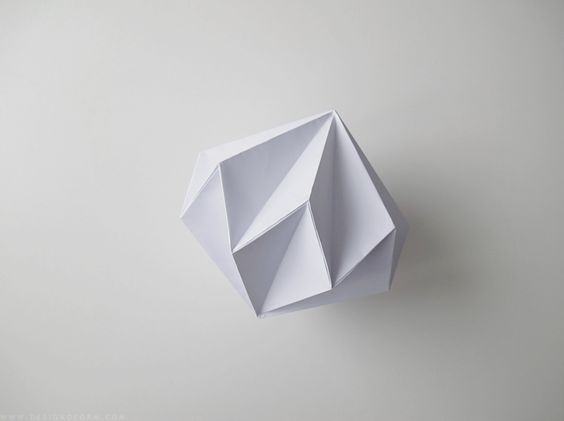 From Emma of Design and Form... fold a diamond from a square of paper.