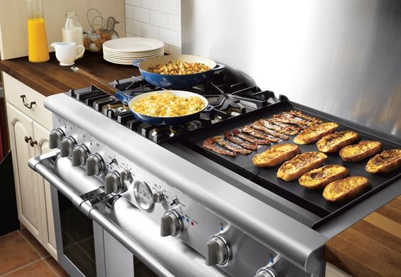 Griddles are a flat cooking surface typically made from steel or cast iron. Items like eggs, pancakes or sandwiches are placed directly on the griddle, as the flat surface allows them to be easily lifted with a spatula. Griddles look similar to French tops, but the main difference is that griddles provide a constant heat over the entire surface, while French tops are the hottest at the center and provide less heat on the sides.