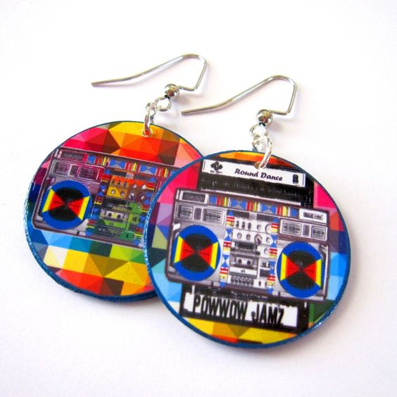 These fun earrings were made by MaRia Bird (Navajo/Hopi/Santa Clara Pueblo) and feature a boombox emblazoned with the words Powwow Jamz and a casse...