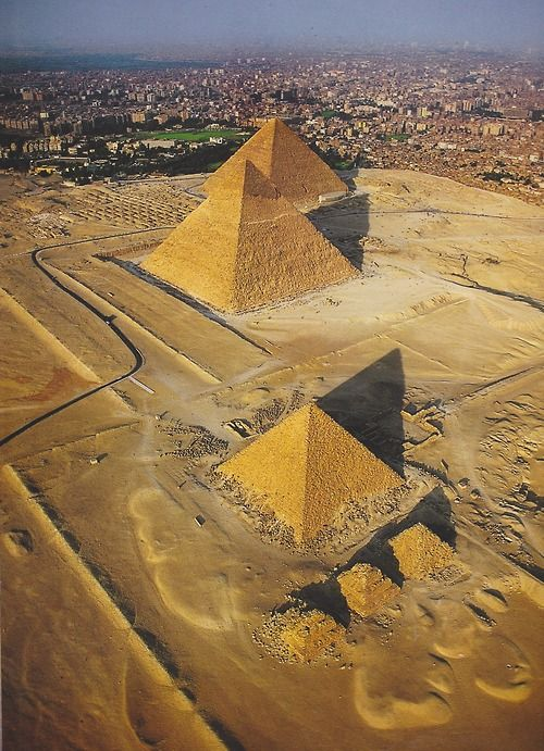Egyptian Pyramids of Giza >>> Great shot, showing how close is the ever expanding metropolis of greater Cairo.