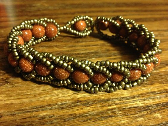 Flat spiral stitch beadwork with sandstone and seed beads. :)
