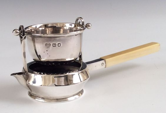 English silver tea strainer and stand with ivory handle, by Goldsmiths & Silversmiths Company, 1916, London, UK