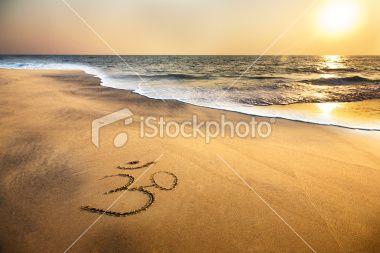 Om symbol on the beach Royalty Free Stock Photo