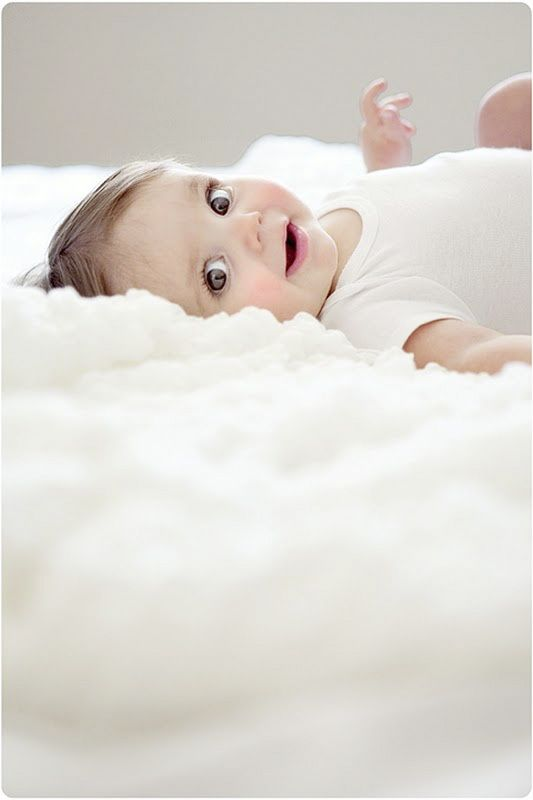 Summer Shoots | Baby and Maternity | Baby laying in bed | Natural light | Very cute expression, rosy cheeks