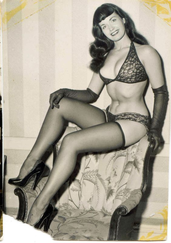 "A gorgeous, old Bettie Page photo found recently. It's even torn in the bottom left corner. Looks like it had photo ""corners"" glued on to it for years."