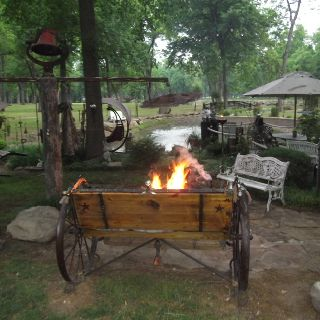 Wagon Wheel Bench And Fire Pit Made From Concrete Culvert