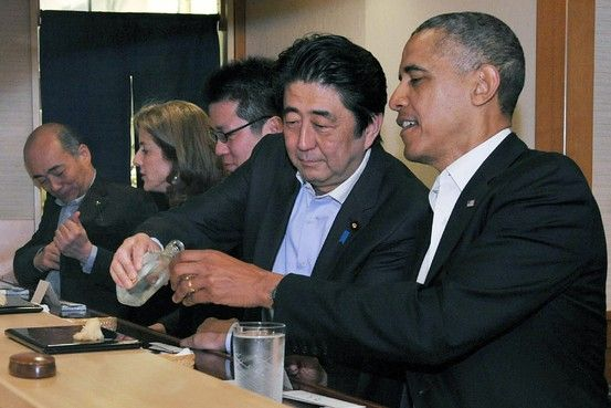 Kyodo/Reuters Japanese Prime Minister Shinzo Abe, second right, talking with President Barack Obama at a Tokyo restaurant on Wednesday.