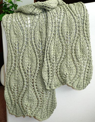 Ogee lace scarf pattern - free pattern.  Useful tip: The construction of this scarf calls for grafting at the center to maintain symmetry, so it is important that both halves are knitted to end on the same RS row of the lace pattern: when  about half of the total yardage is knitted up, make note of the row number and then knit the second section the same length.