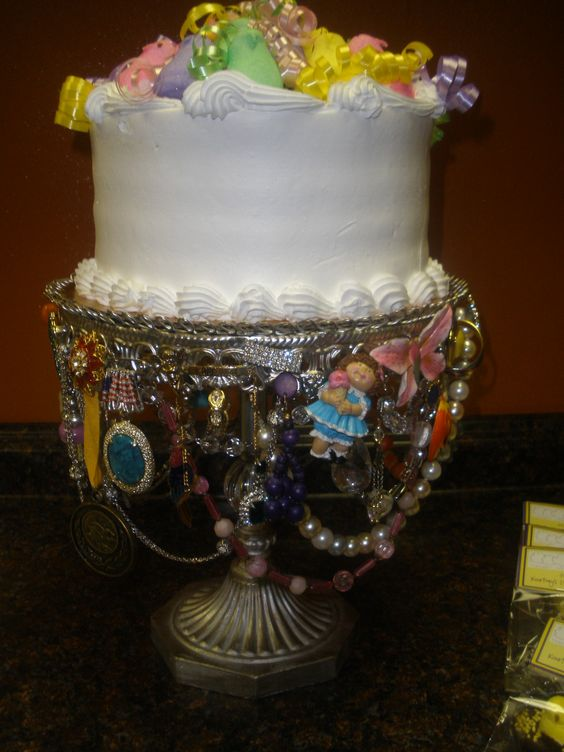 """Peep-day Cake on a Unique Cake Stand by...""""Junk in the Trunk"""" - White Cake with Bavarian Creme Filing purchased at Rao's Bakery in Houston, Texas..then I added the Peeps and Curling Ribbon...placed on Cake Stand purchased at Ross..then decorated with memorable jewelry !"""
