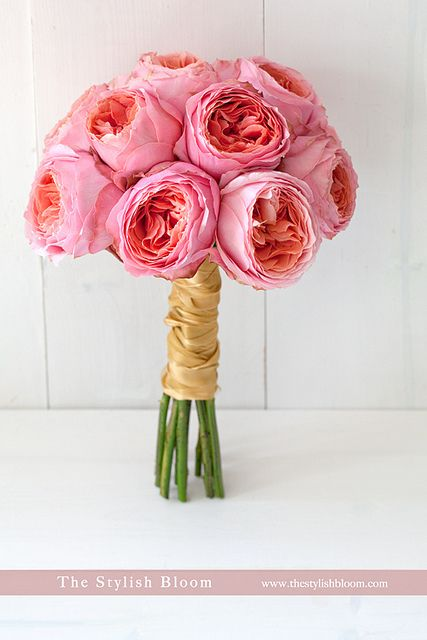 cabbage roses are available in august...the look of a peony, are in season, and much less expensive
