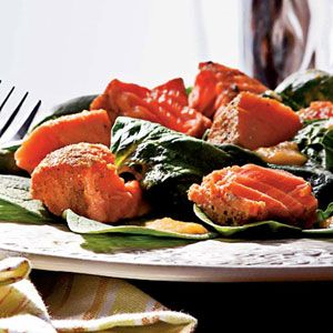 Grilled salmon spinach salad with peach dressing