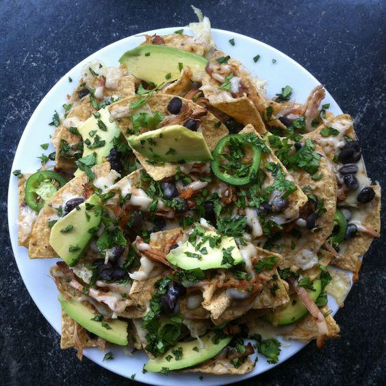 One badass plate of nachos!  Fresh tortillas, Queso Chihuahua, Black beans, Salsa roja, Carnitas, Cilantro, Jalapeño, Radish, Avocado.