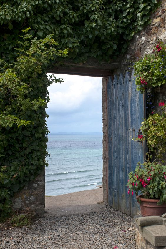 An entryway to the beach can look however it likes, but flowers and vines just make the path that much more alluring.: