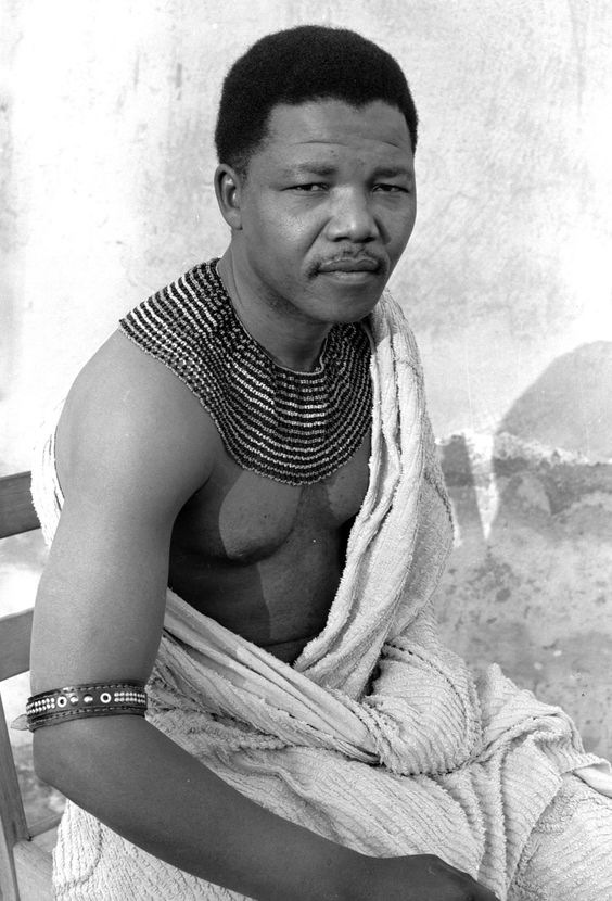 Nelson Mandela as a young man, looking focused and determined in traditional Xhosa dress in 1961.
