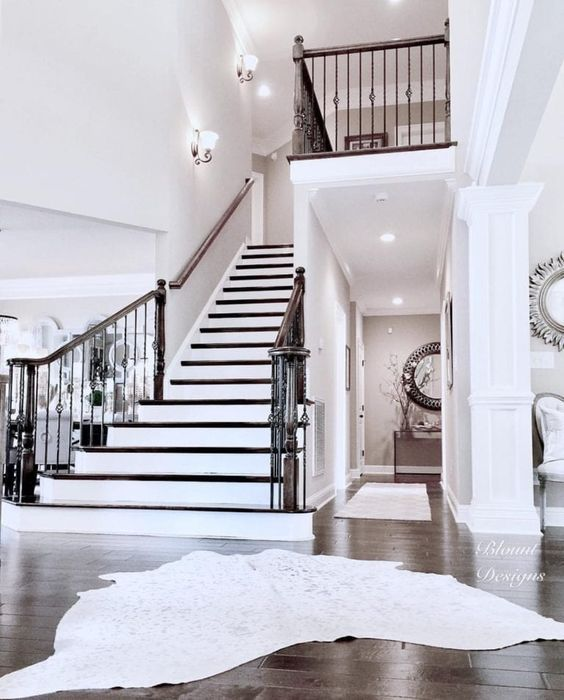 Central Staircase In Bright White Home With Images House