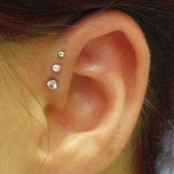 Triple forward helix piercing. Kinda like this. May have to get it.