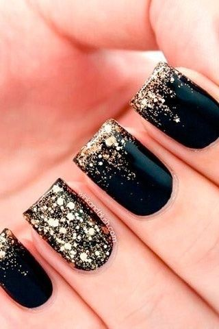 black and gold glitter nails. New years