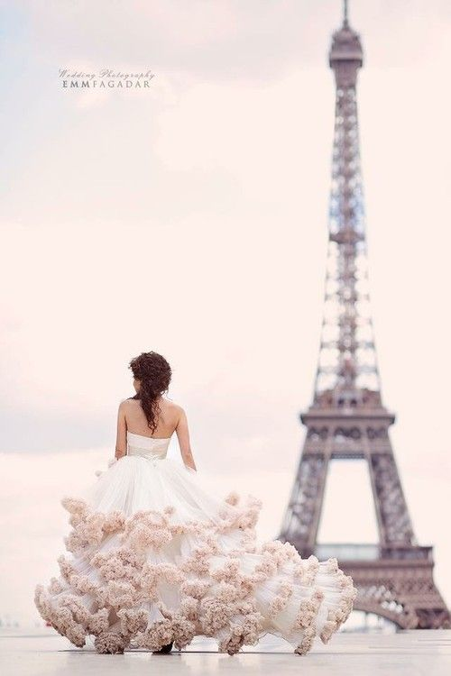 Love the organic nature of the gown next to the geometric architecture of the Eiffel Tower