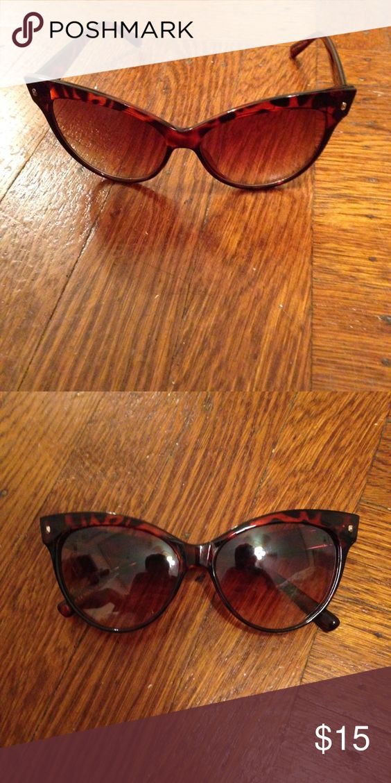 Dark tortoise or black cateye sunglasses Dark brown tortoise cateye sunglasses. Also available in black for same price. Barely worn. Buy both for $15. AKIRA Accessories Sunglasses