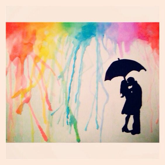 Silhouette Of Two People Under An Umbrella